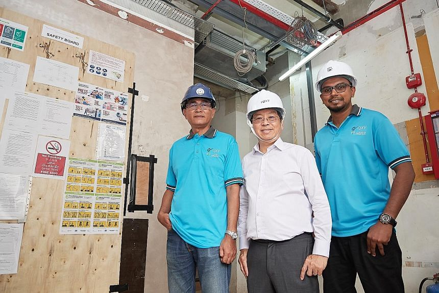 QXY Resources' head of safety Mohd Yazid Mohd Yasin (from far left) with the company's managing director Patrick Koh and management associate Shanthakumar Sinniah.