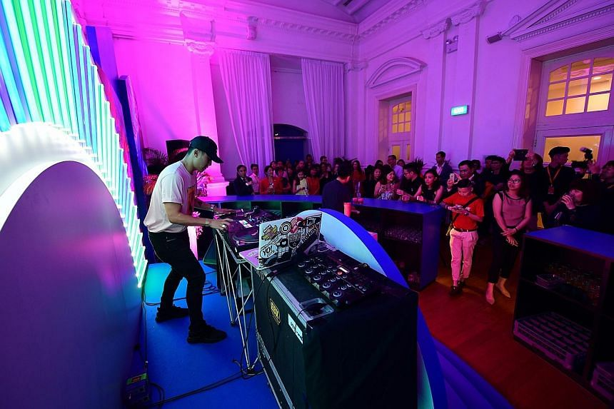 DJ KoFlow, one of the 80 home-grown talents to be featured in the Singapore Tourism Board's new campaign, playing a set at the launch event at the Arts House yesterday. The STB will organise several overseas events under the Passion Made Possible bra