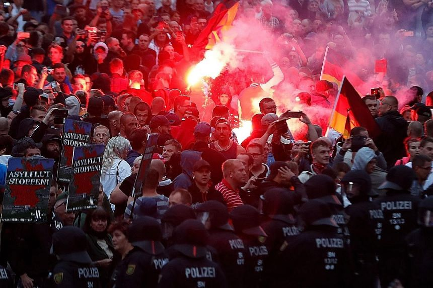Demonstrators staging a protest on Monday in Chemnitz, in eastern Germany, following the fatal stabbing of a 35-year-old German man, which provoked clashes between far-right and leftist supporters. Police said nearly 20 people were injured in Monday'