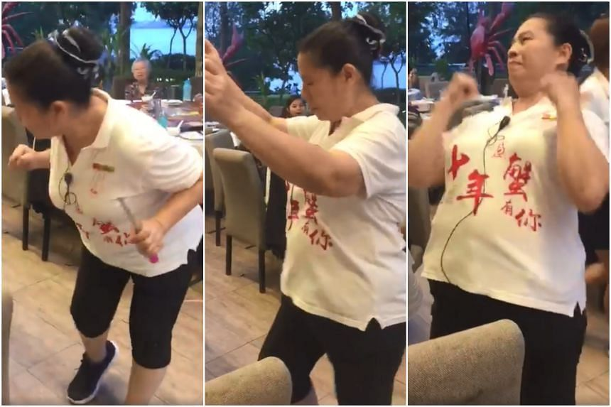 The video, which was uploaded on Facebook, has Madam Loh Feng Ling showing off some sprightly moves to an upbeat song that contains the sounds of chickens clucking, as she serves up a $38 flambeed chicken dish to customers.