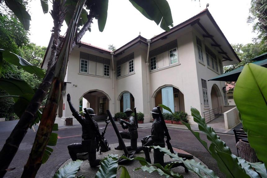 A sculpture of a Malay Regiment three-inch mortar team in action outside Reflections at Bukit Chandu, symbolising battle-readiness, discipline and tenacity of the men in combat.