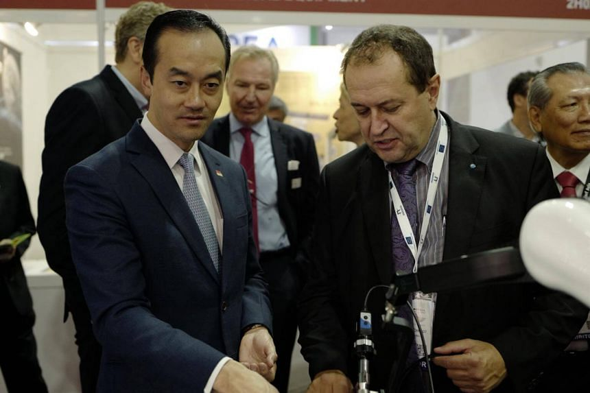 Senior Minister of State for Trade and Industry Koh Poh Koon (left) at the Medical Fair Asia 2018 at Marina Bay Sands, on Aug 29, 2018.