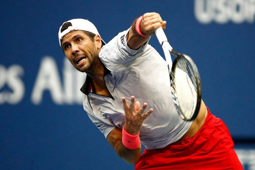 Fernando Verdasco of Spain serves during his men's singles second round match against Andy Murray of Great Britain.
