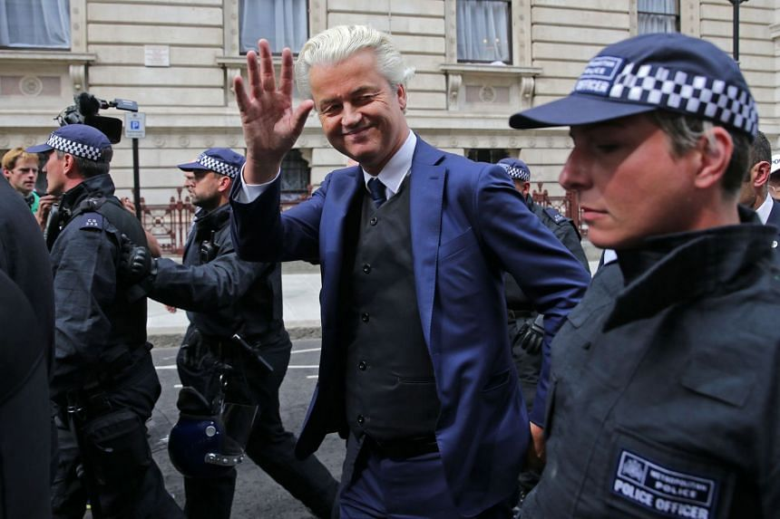 Wilders (centre) is escorted away by police after speaking at a far-right gathering in London in June 2018.