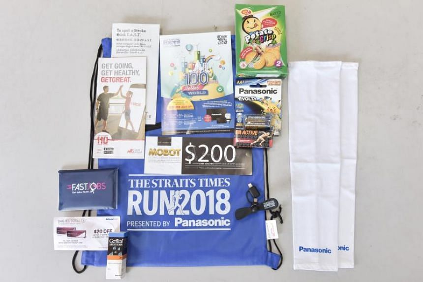 Items in The Straits Times Run goodie bag include arm sleeves, a mini USB fan, lubricant eye drops from GenTeal and Tiger Balm Active Muscle Rub.