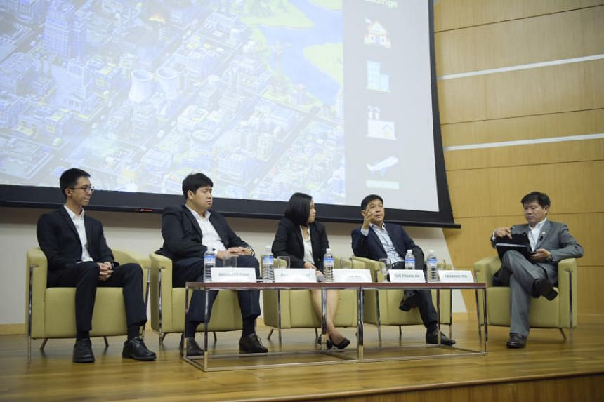Speaker of Parliament Tan Chuan-Jin (second from right) takes part in a youth dialogue organised by Temasek at the Singapore Management University on Aug 30, 2018.