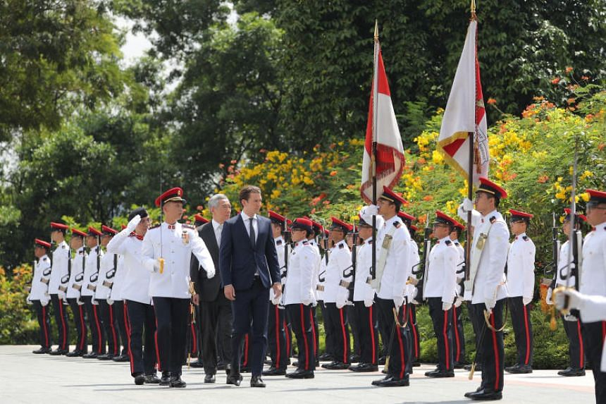 Prime Minister Lee Hsien Loong with Austrian Chancellor Sebastian Kurz during an official welcome ceremony at the Istana on Aug 30, 2018.