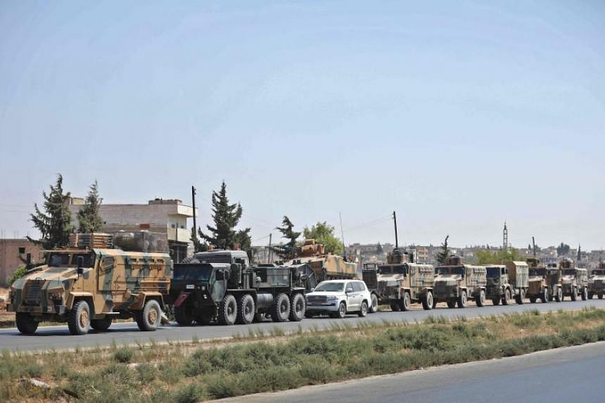 Turkish forces are seen in a convoy on a main highway between Damascus and Aleppo, near the town of Saraqib in Syria's Idlib province, on Aug 29, 2018.