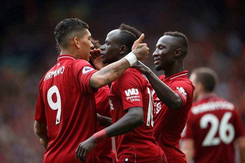 Liverpool's Sadio Mane celebrating a goal with Roberto Firmino and new signing Naby Keita.