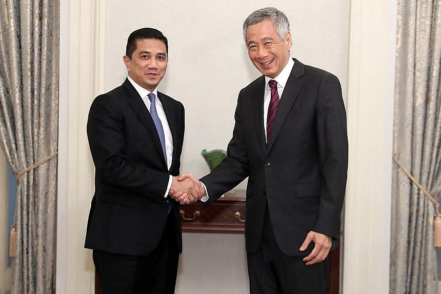 Prime Minister Lee Hsien Loong with Malaysian Economic Affairs Minister Azmin Ali.
