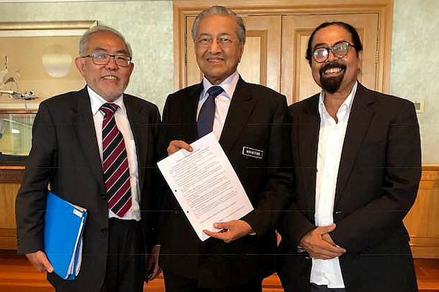 (From left) Fugitive and former Singapore student union leader Tan Wah Piow with Malaysian Prime Minister Mahathir Mohamad and Malaysian political and social activist Hishamuddin Rais in Putrajaya yesterday.