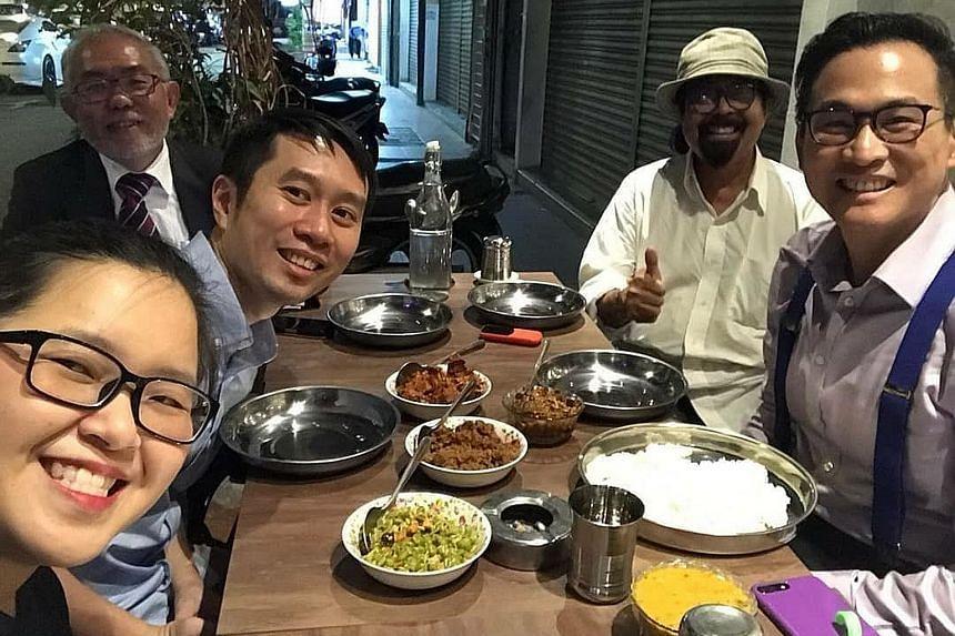 (Clockwise from far left) Singapore activists Kirsten Han and Jolovan Wham, Tan Wah Piow, Mr Hishamuddin Rais and academic Thum Ping Tjin having dinner in Kuala Lumpur yesterday.