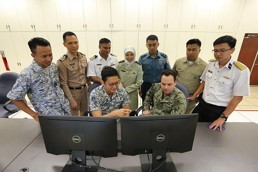 Liaison officers from the navies from the United States, Singapore, Bangladesh, Indonesia, Malaysia, Thailand, Brunei, Vietnam and the Philippines planning for Exercise Seacat at the RSS Singapura - Changi Naval Base yesterday.
