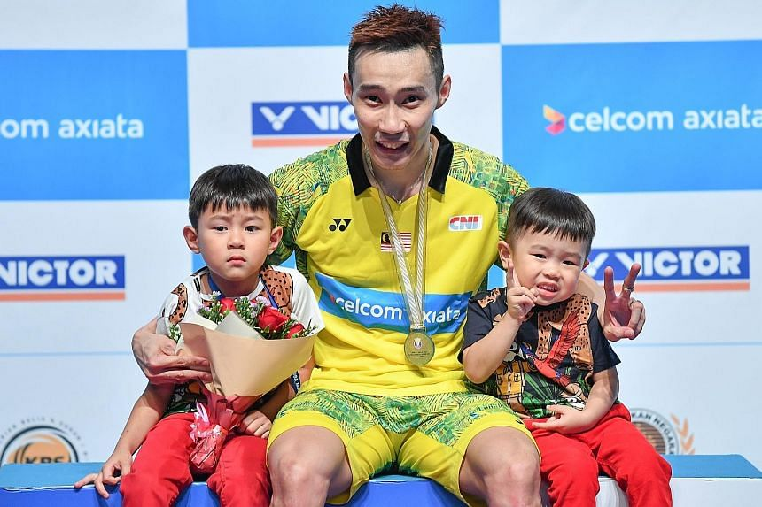 Lee Chong Wei with his sons Kingston (far left) and Terrance after winning the Malaysia Open on July 1. He was beaten in the semi-finals of the Indonesia Open the week after, his last tournament before taking ill.