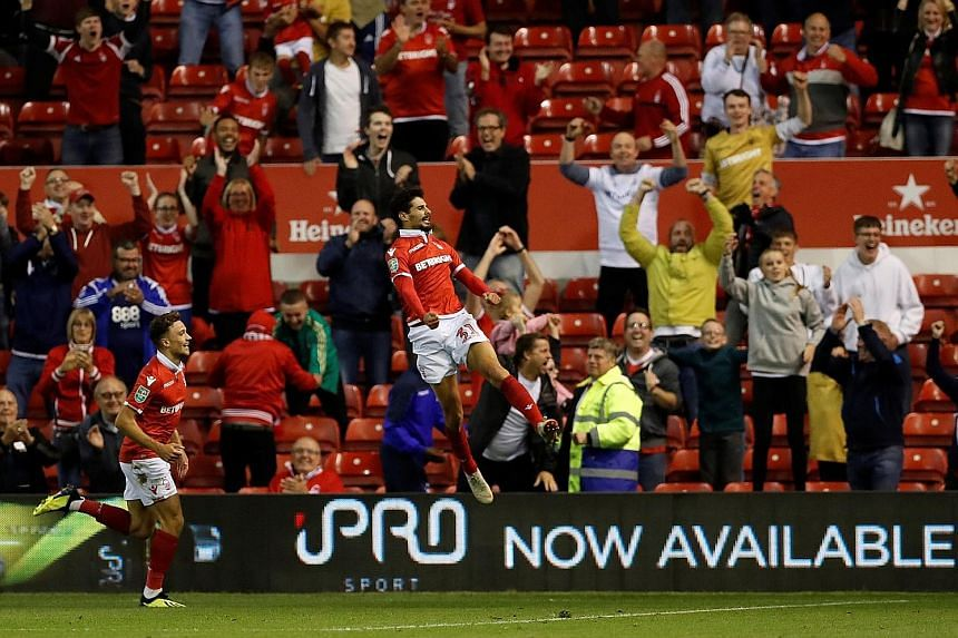 Gil Dias celebrating scoring Nottingham Forest's third goal to make it 3-1 against Newcastle in their League Cup second-round game.