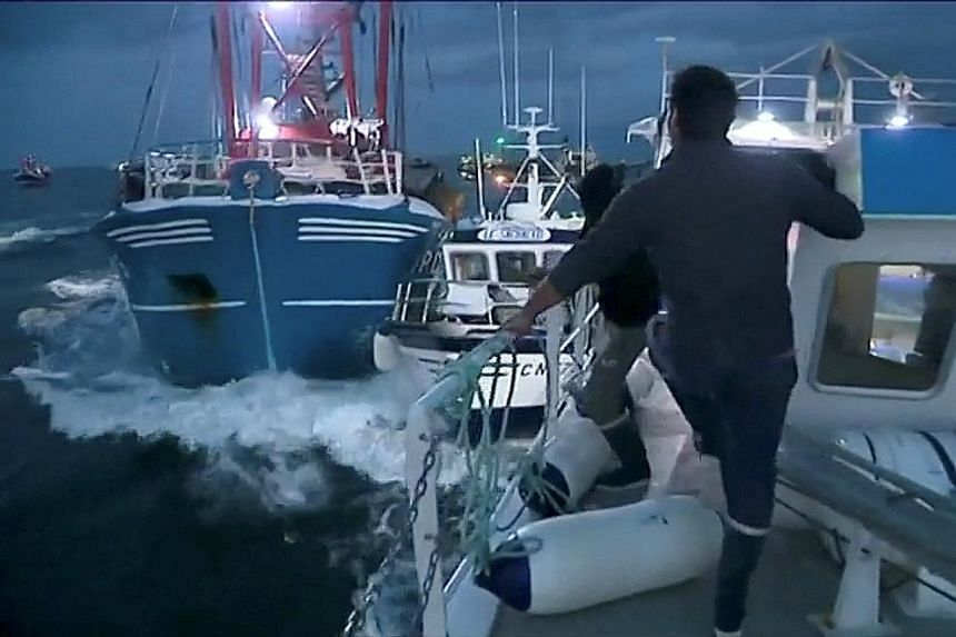 A still image taken from a video shows French and British fishing boats colliding during the scrap in the English Channel on Tuesday over scallop fishing rights.