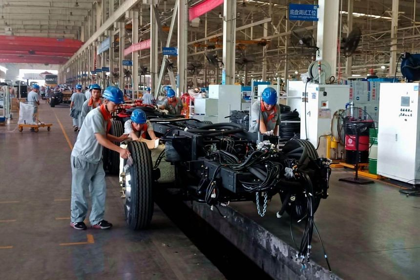 Employees working on an electric bus production line at a factory in Liaocheng in China's eastern Shandong province.