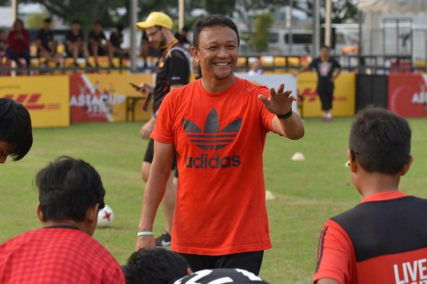 Fandi Ahmad conducting a football clinic for 20 Straits Times School Pocket Money Fund beneficiaries on Aug 5, 2018.