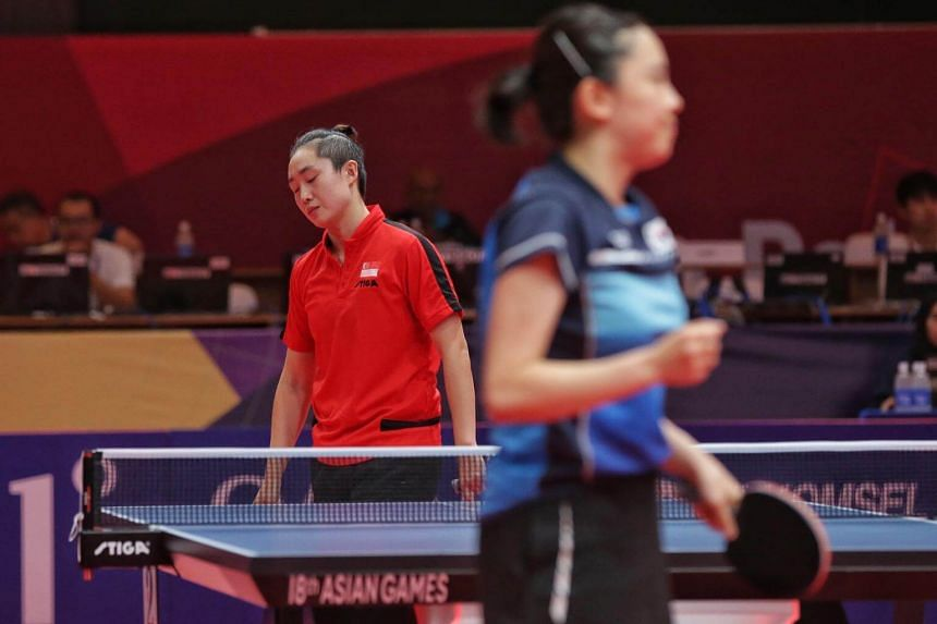 Singapore's Feng Tianwei reacts after losing the match to South Korea's Jeon Ji-hee in table tennis women's singles round of 16 at the 18th Asian Games in Jakarta, on Aug 31, 2018.