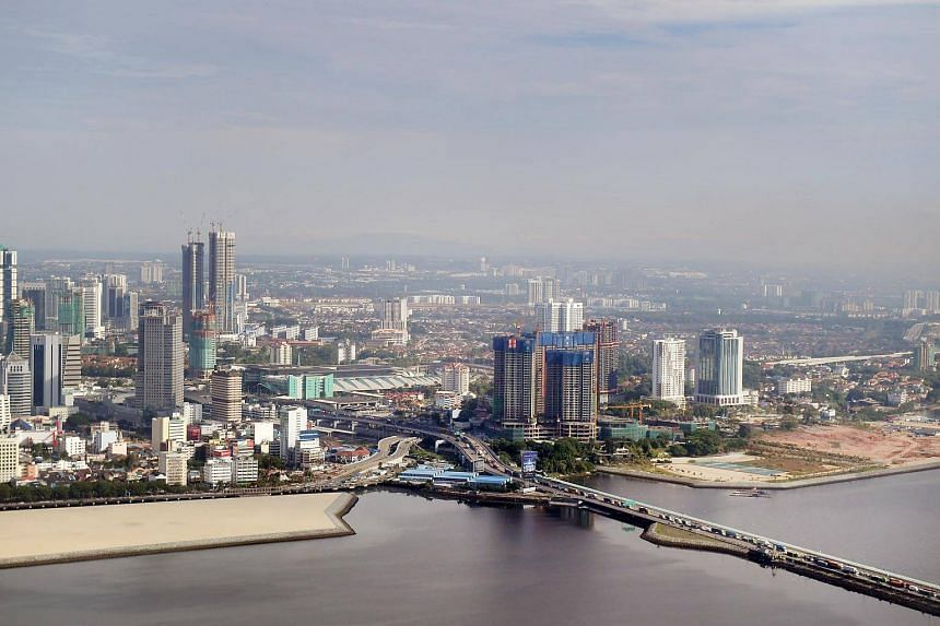 Singapore is currently linked to Johor via a very busy Causeway to the north (above) and a bridge from Tuas, the western part of the island state.