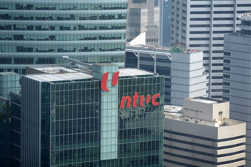"""NTUC Assistant Secretary-General Patrick Tay said financial sector workers can """"expect their jobs to evolve and roles to change""""."""