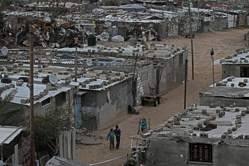 Palestinian refugee children play outside their families' houses at the Khan Younis refugee camp in the southern Gaza Strip, on Jan 19, 2018.