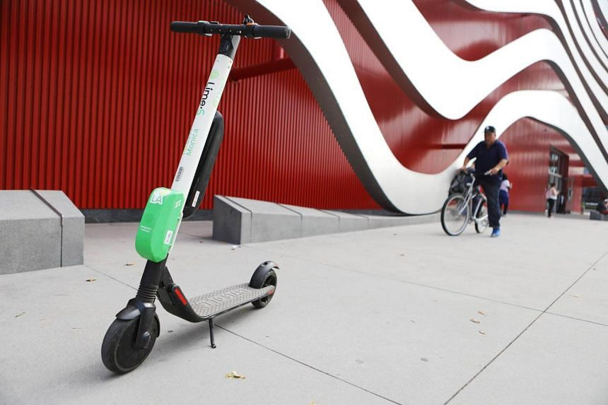 A Lime dockless electric scooter parked on a Wilshire Boulevard sidewalk on July 9, 2018.