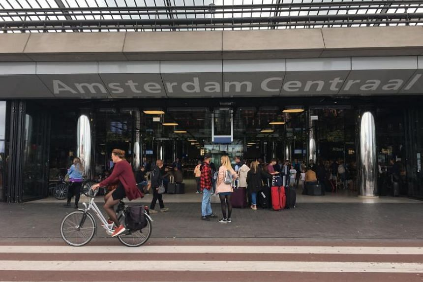 Passengers outside the Central Railway Station in Amsterdam on Aug 31, 2018, after two people were hurt in a stabbing incident.