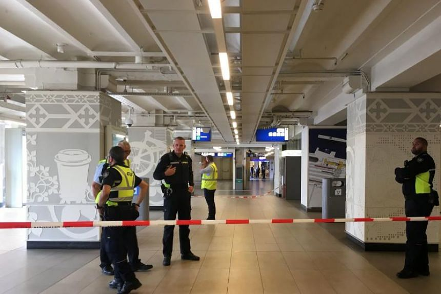 Security officials cordon off an area inside The Central Railway Station in Amsterdam on Aug 31, 2018, after two people were hurt in a stabbing incident.