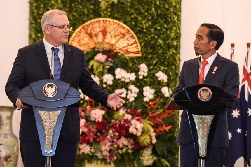 Indonesian President Joko Widodo (right) listens to Australian Prime Minister Scott Morrison at a news conference at the presidential palace in Bogor, Indonesia, on Aug 31, 2018.