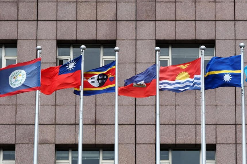 The national flags of (from left) Belize, Taiwan, eSwatini, Haiti, Kiribati and Nauru fly outside the Diplomatic Quarter in Taipei on Aug 23, 2018.