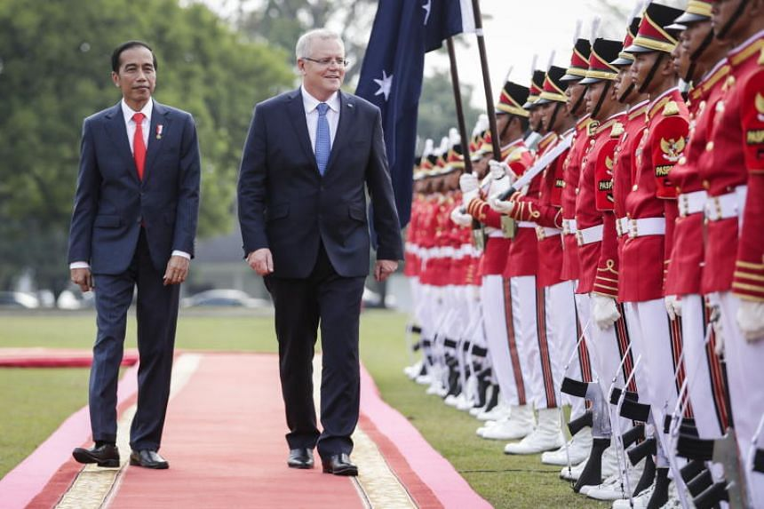 Australian Prime Minister Scott Morrison (centre) and Indonesian President Joko Widodo inspect the guard of honour during a welcoming ceremony at the Presidential Palace in Bogor, West Java, Indonesia, on Aug 31, 2018.
