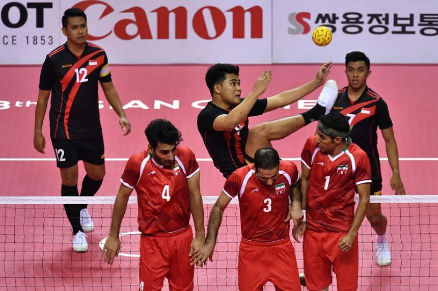 Singapore's Muhammad Asri Bin Aron (centre) in action during the final Group B fixture of the Asian Games sepak takraw quadrant competition against Iran on Aug 31, 2018.