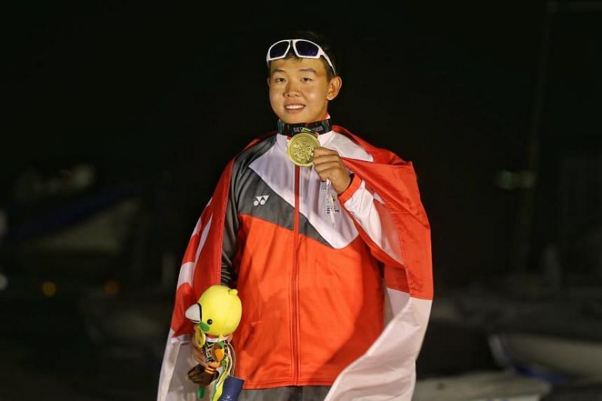Singapore's Ryan Lo with his bronze medal from the Laser Standard class of the sailing competition at the Asian Games in Jakarta on Aug 31, 2018.