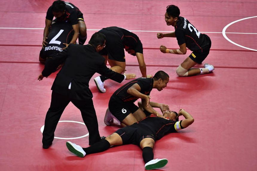 The Singapore team rejoicing after winning the final Group B fixture of the Asian Games sepak takraw quadrant competition against Iran on Aug 31, 2018.