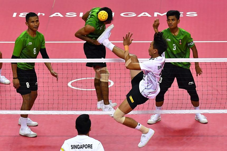 Singapore's Muhammad A'fif Bin Safiee in action during the Asian Games sepak takraw quadrant semi-finals against Indonesia on Aug 31, 2018.