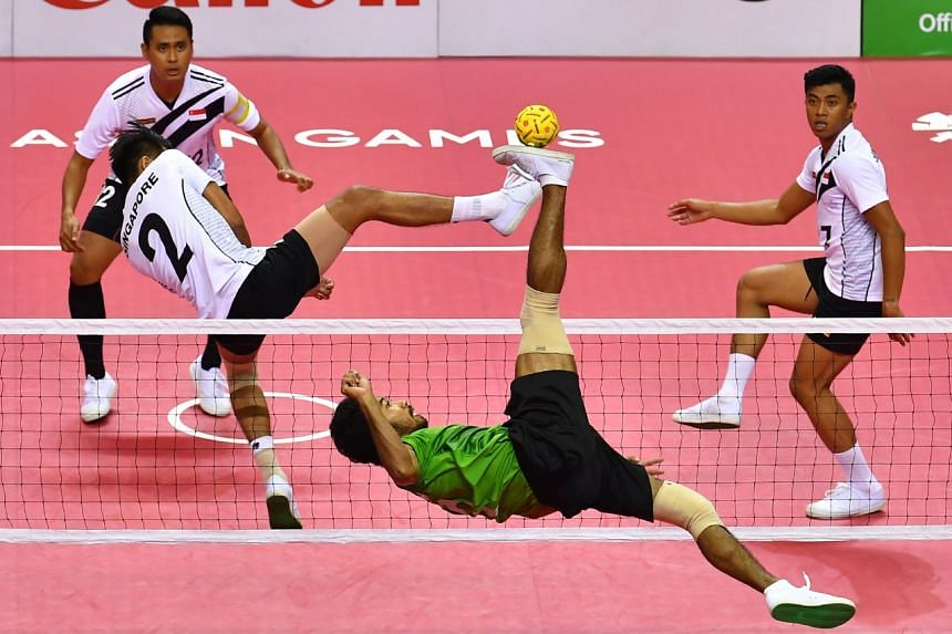 Indonesia's Saiful Rijal in action during the Asian Games sepak takraw quadrant semi-finals against Singapore on Aug 31, 2018.
