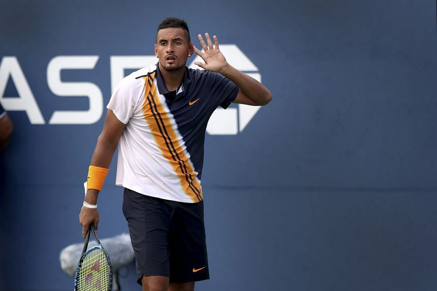 Kyrgios puts his hand up to his ear to encourage the cheering crowd before closing out his win.