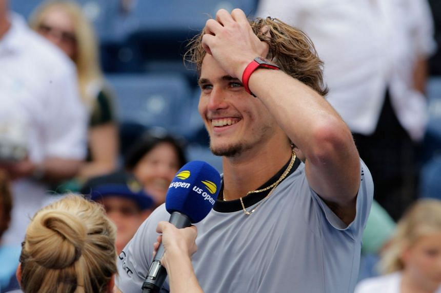 Zverev smiles as he is interviewed after defeating Nicolas Mahut of France.