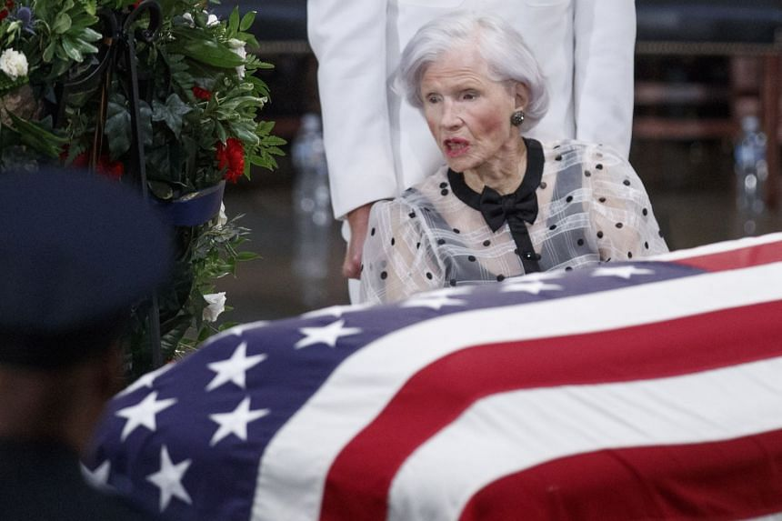 Roberta McCain takes a moment at the casket of her son, Senator John McCain.