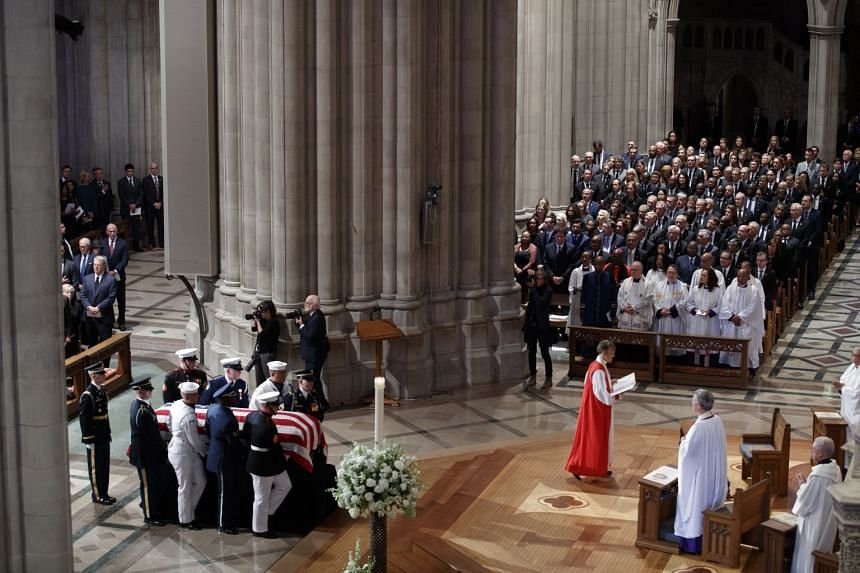 The casket of Senator John McCain is carried by a joint service honour guard during his memorial service.