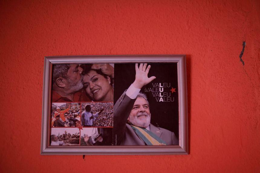Pictures of former Brazilian President Luiz Inacio Lula da Silva are seen inside community radio, in Caetes, Brazil.