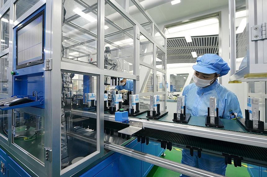 The production line for lithium-ion batteries for electric vehicles at a factory in Huzhou, Zhejiang province, China.