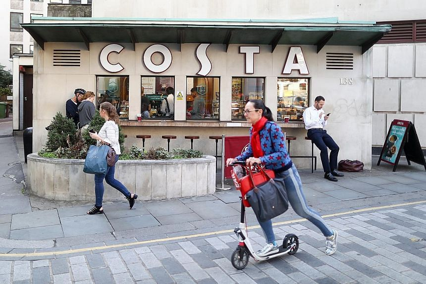 A Costa Coffee outlet in London. Coca-Cola is buying the British chainfor £3.9 billion (S$6.94 billion). Costa operates more than 3,800 stores in 32 countries.