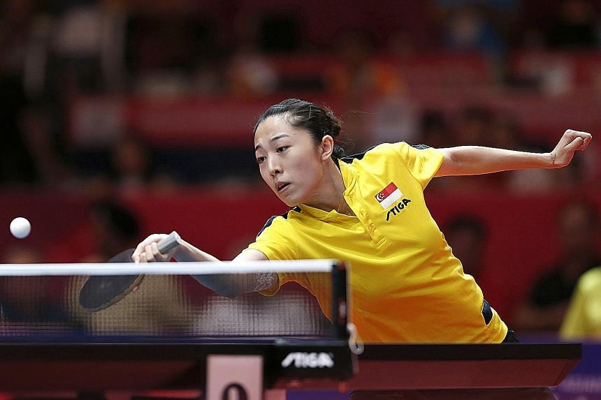 Yu Mengyu in control yesterday against Chinese Taipei's Cheng I-ching, whom she outplayed 11-7, 11-6, 9-11, 11-4, 11-3 to reach the women's singles semi-final for Singapore's only table tennis medal at these Games.