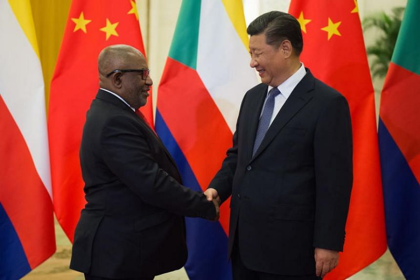 Comoros' President Azali Assoumani shakes hands with China's President Xi Jinping before their bilateral meeting in Beijing on Sept 1, 2018. Mr Assoumani is in China for the Forum on China-Africa Cooperation, which will begin on Sept 3, 2018.