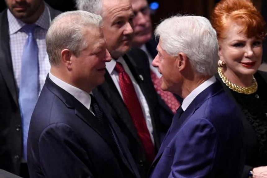 Former US vice-president Al Gore and former US president Bill Clinton arrive for the Memorial Service for US Senator John McCain at the Washington National Cathedral on Sept 1, 2018.