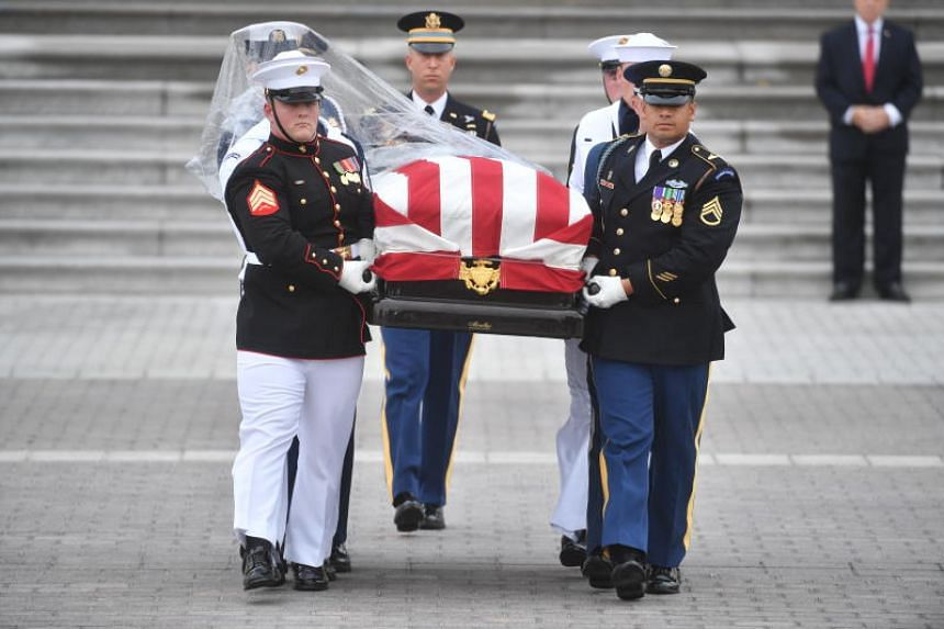 The casket of Senator John McCain is carried down the steps of the US Capitol in Washington, DC, on Sept 1, 2018.