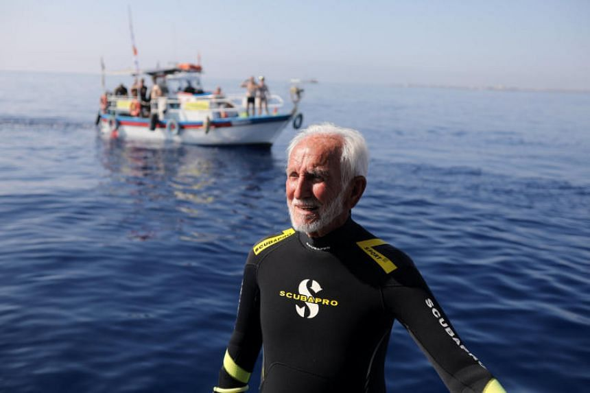 Mr Ray Woolley dived for 44 minutes at a depth of 40.6m on Sept 1, 2018, beating his previous record of 41 minutes and 38.1m - when he was 94.