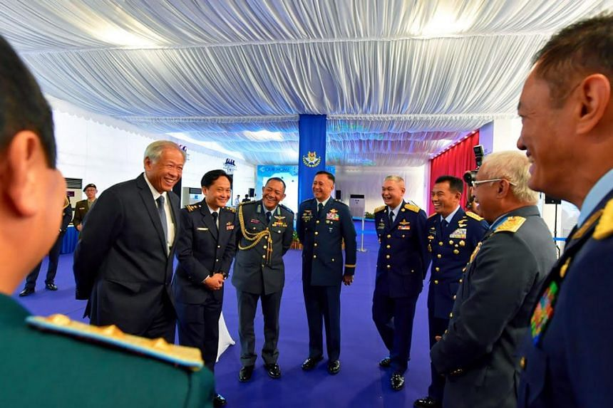 Defence Minister Ng Eng Hen with Asean's air force chiefs and the deputy chief of the Air Force Department of the Lao People's Army at the RSAF's 50th anniversary parade at Tengah Air Base on Sept 1, 2018.